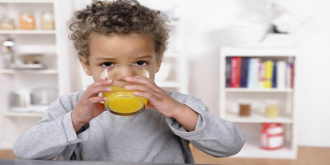 Wiki Juices - Boy drinking orange juice