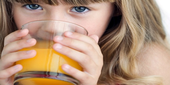 Wiki Juices - Young girl drinking orange juice