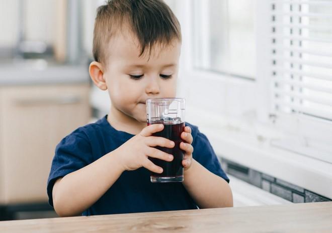 Wiki Juices - Baby Boy Drinking Prune Juice